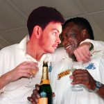 a photoshopped image of ollie holmes giving devon malcolm some coaching advice